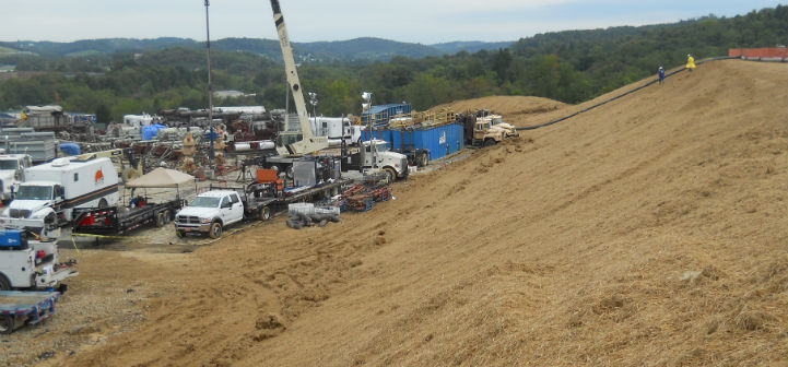 The impoundment berm bordering a Marcellus Shale gas play drilling pad in western Pennsylvania